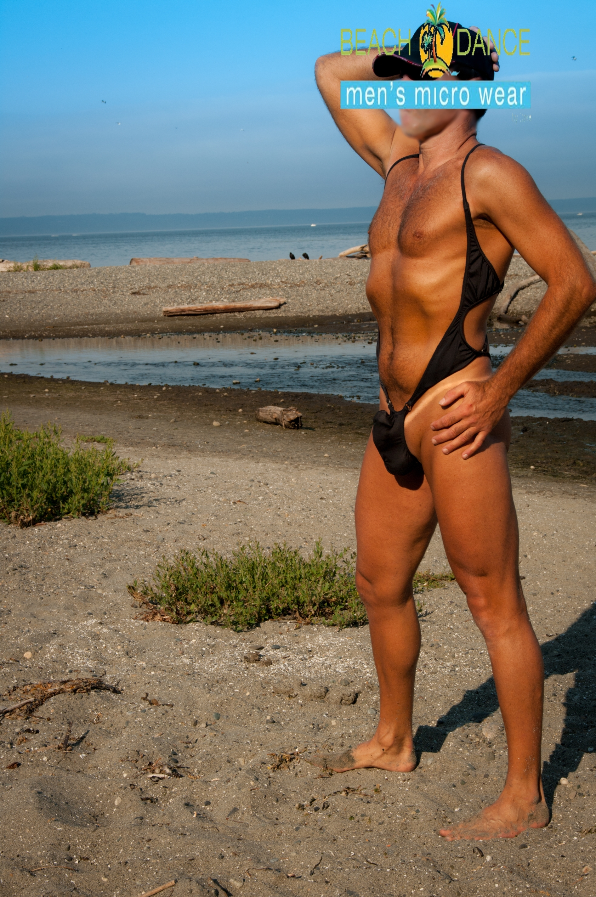 relaxin at the beach in a suspender thong